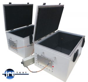Two JRE 1812 test enclosures interconnected with antennas and step attenuator.