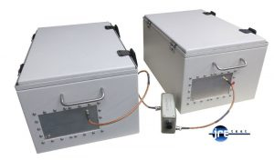 Two JRE 1812 test enclosures interconnected with antennas and step attenuator. Boxes are closed so all signals between the enclosures have to pass through the step attenuator.